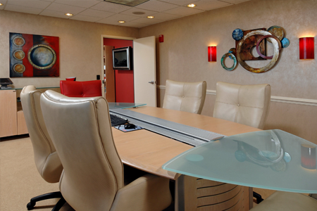 Designed board room in office with tan leather chairs