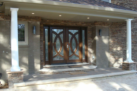 Double front doors with ornamental wood and glass