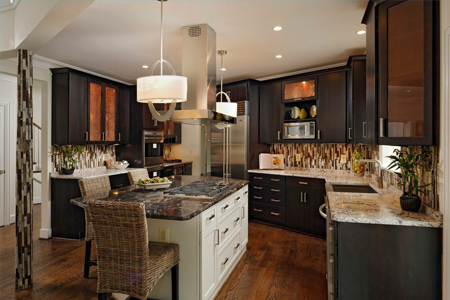Kitchen with accent tiles, dark cabinet and chandeliers