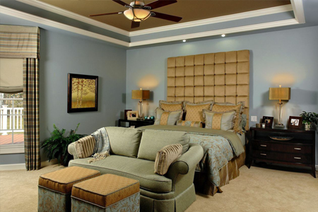 Bedroom design with bed, sofa and ottomans